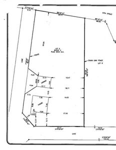 Innisfail R3 zoned, half acre lot