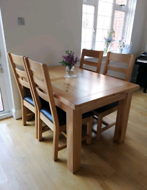 DFS Solid Oak extending dining table and chairs