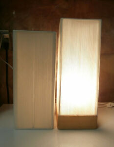 Table Lamp On A Wooden Base With A Nice Lamp Shade