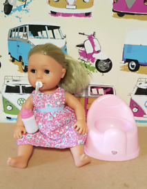 Tiny tears doll with dress bottle, dummy and potty Smoke and pet free
