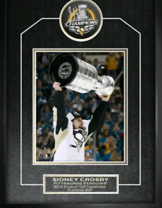 Sidney Crosby signed Stanley cup puck framed with 8 x 10 photo.