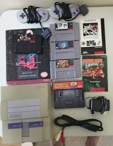 Super Nintendo w/ 4 games and game genie