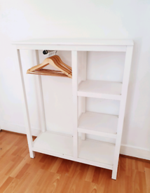 White clothes hanger and shelves