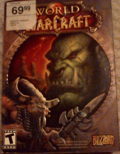World of WarCraft with 3 CDs & ALL inserts.  (like new)