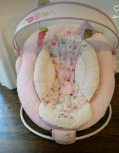 Pink and white bouncer