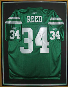 Framed Autographed George Reed Roughrider Jersey