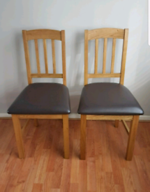 Brand new pair of oak dining chairs