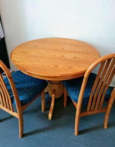 Solid wood dining table with leaf and chairs