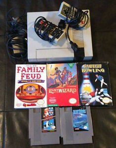 Regular Nintendo with 2 controllers and 5 games!!