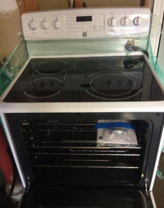 Like new! White Kenmore electric range with ceramic glass top.
