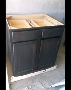 "wooden 2-door cabinet. selling as is.H-35"" D-24"" W-30"""