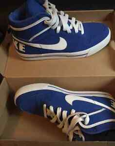 Brand new Nike blue and white high top shoes