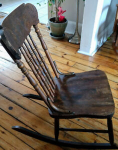 Antique solid wood rocking chair with hand carved detailing