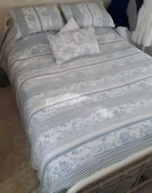 Kingsize metal bed frame / hospital style cream bedspread Dorset