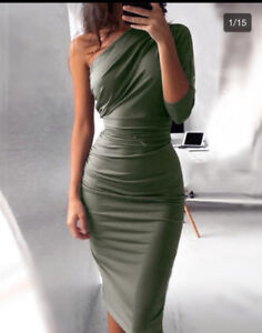 Selling a fitted olive green dress