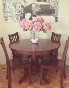 Dinning table with 4 chairs.  Solid wood.