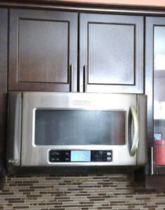 KitchenAid  microwave oven with a ventilation hood for sale.