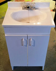 Bathroom Sink with taps.  20 inches wide, 32 inches tall