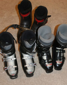 Lots and lots of downhill ski boots, mondo size 24 - 28