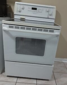 Whirlpool gold (white)electric range for sale.