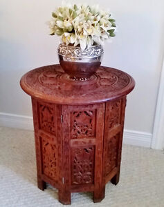 Beautiful carved table with inlaid design - excellent condition