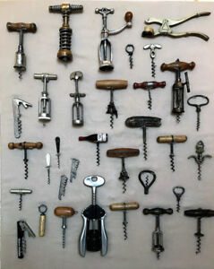 32 VINTAGE CORKSCREWS ON A DISPLAY BOARD