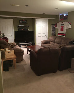 brown microfiber couch and loveseat