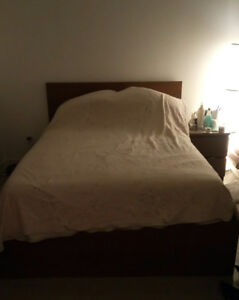 Double bed w/ mattress with underbed storage and side table