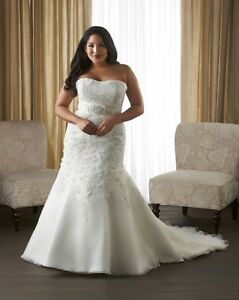 PLUS SIZE GOWNS 12-36.    At Bridal Plus Boutique
