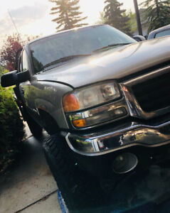 Lifted 2500 GMC Flat deck