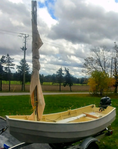 Sherpa 9ft wooden sailboat, trailer and motor package.