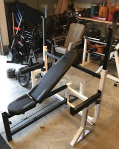 weight lifting bench Olympic and dumbell