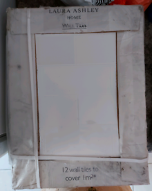 Laura and Ashley white pattern wall tile .