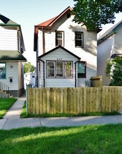 Machray Ave 2bdr main flr includes heat, water, parking, laundry