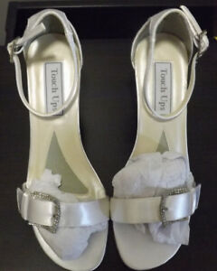 White wedge shoe with rhinestone buckle. $50