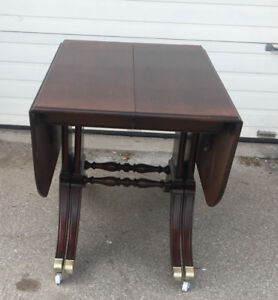 "A long practical antique table, drop sides (extendable to 116"")"