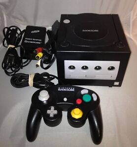 nintendo gamecube with controller and 5 games