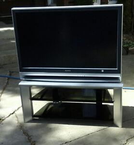 Sony tv and 2 shelf stand