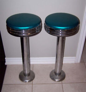 "Pair of Retro Chrome/Vinyl Diner stools and ""Pontiac"" Neon Clock"