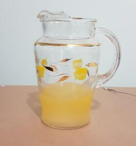 antique juice pitcher