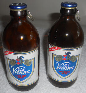 2 unique OV stubby beer bottles with rip caps