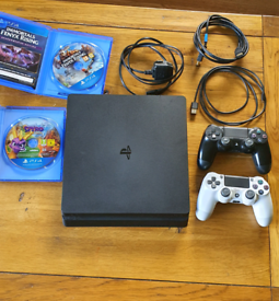 Playstation 4 (PS4) console, controllers and 2 games