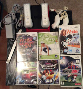 Nintendi Wii Mini With 2 Controllers/Nunchucks and 6 Games!