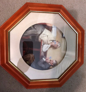 11 Norman Rockwell Plates framed..... All numbered in frames..
