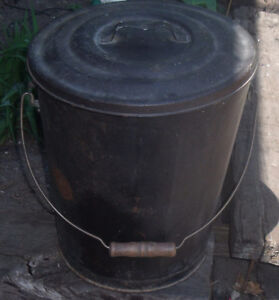old metal bucket with lid