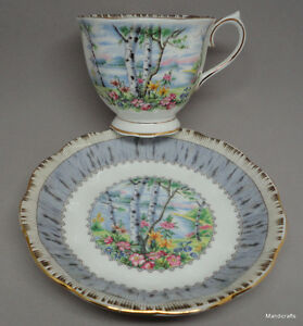 SILVER TEA CUP AND SAUCER