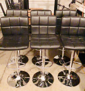 6 faux leather swivel bar chairs.  Lever controlled. $250.00 OBO