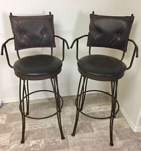 Solid rod iron bar stools with dapple brown suede cushions