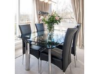 Harveys Contemporary Design Black and Clear Glass Dining Table and Six Chairs