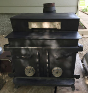 "WOOD BURNING STOVE ""BIGGER"" BRAND W/2 LENGTHS OF STAINLESS PIPE"